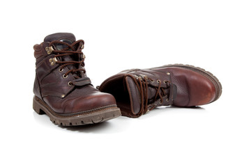a pair of Brown leather hiking boots on white