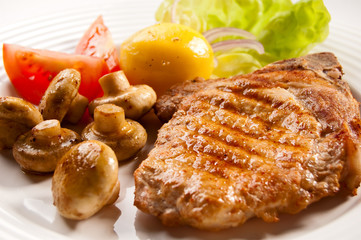 Grilled meat with boiled potatoes and vegetable salad