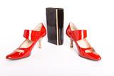 new elegant Shoes on a high heel and varnished leather handbag poster