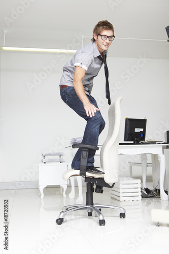 Man skateboarding on a chair