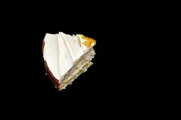 Cake slice on black background