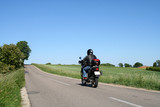biker driving away poster