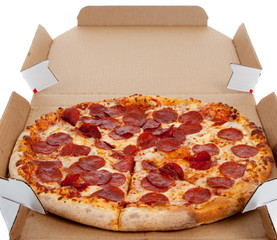 Pepperoni pizza in a box on white