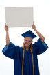 Graduating girl holding copyspace