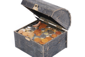 Many coins in one old chest isolated