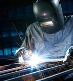 welding in workshop poster