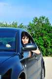 young brunette driving car poster