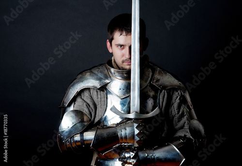 Warrior holding his great sword - 18770335