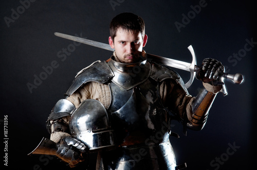 Great knight holding his sword and helmet - 18770396
