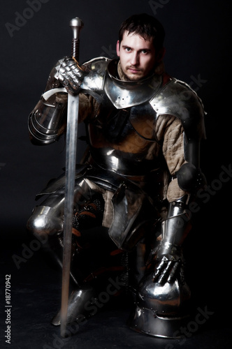 Great knight holding his sword and helmet