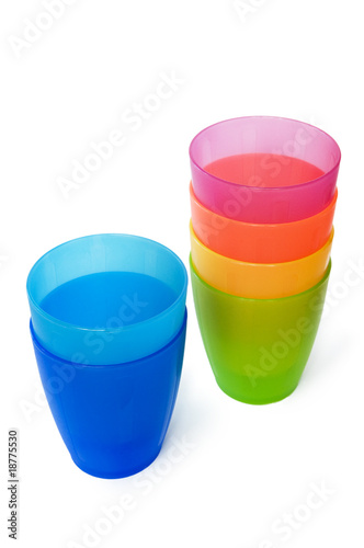Plastic cups of various colours isolated on white
