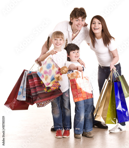 Happy family and children with shopping bag. Isolated.