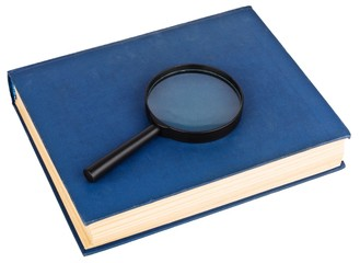 Blue book and magnifying glass isolated on the white