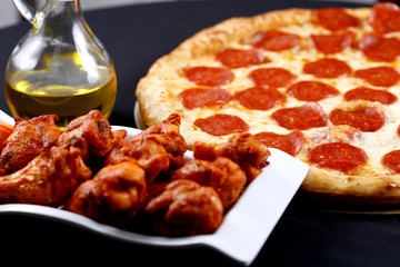 pepperoni pizza and chicken wings combo