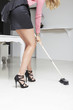 Sexy woman cleaning office