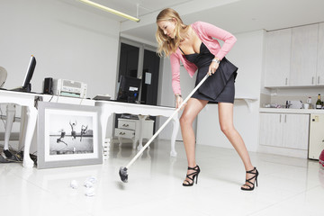 Attractive woman cleaning an office
