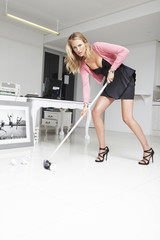 Young employee cleaning an office