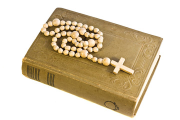 old holy bible with cross