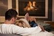 Couple sitting at fireplace - 18793167