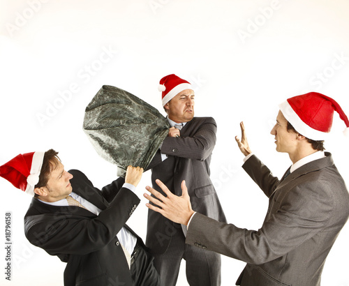xmas businessmen fighting for presents