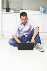 Young businessman with his computer