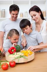 Happy parents and children cooking