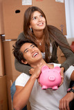Couple with piggybank