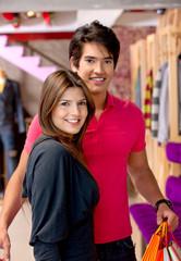 Shopping couple smiling