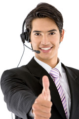 Thumbs-up business man with headset