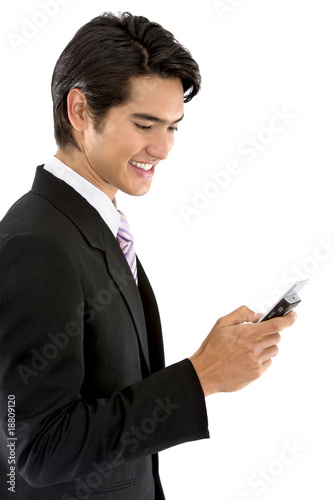 Business man texting from his cel