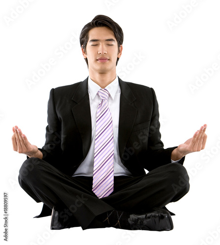 Business man doing yoga
