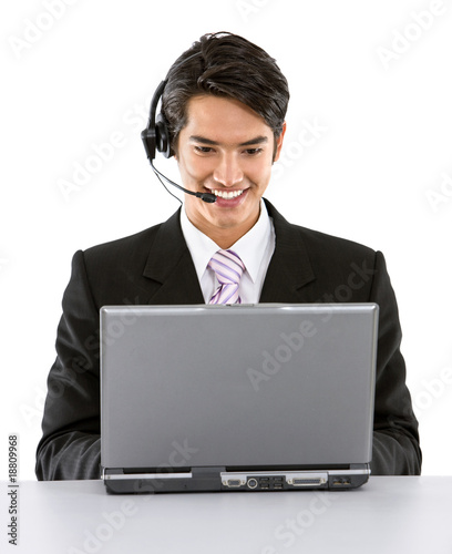 Business man with headset and laptop