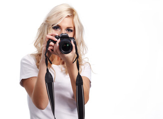 Beautiful smiling woman with digital camera. Isolated on white b
