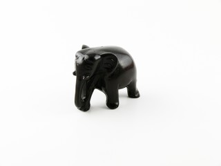 Carved wooden elephant figurine on a white background