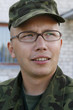 Young army cadet with glasses