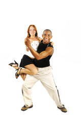 Latino dance instructor carrying girl