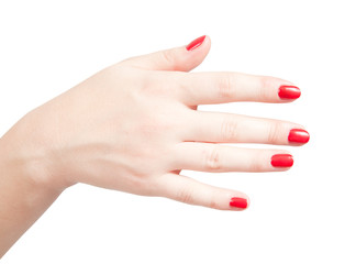 Fingers with red nails on white