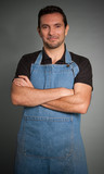 Smiling man with apron poster
