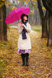 Beautiful young girl under umbrella