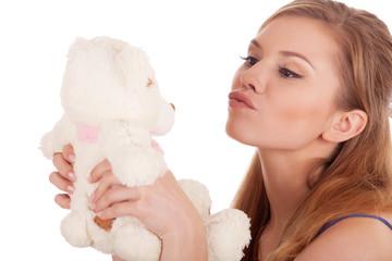 girl kissing  teddy bear