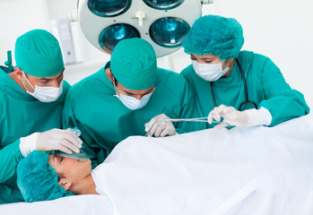 Surgeons near patient lying on an operating table