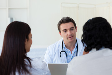 Male doctor explaining diagnosis to a couple
