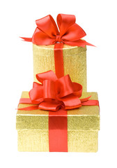 Two gold gift boxes with red ribbons
