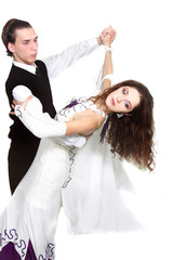 young attractive couple dancing over white