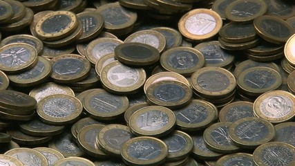 Euro coins dropping in a counting machine