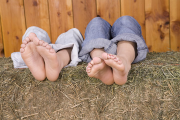 Bare feet on hay