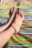 varnished woman toenails poster