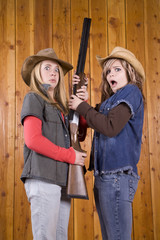 girls and gun looking scared