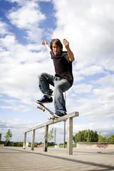 Skateboarder doing a crooked grind