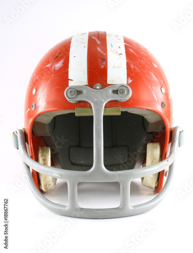 Old used football helmet front view
